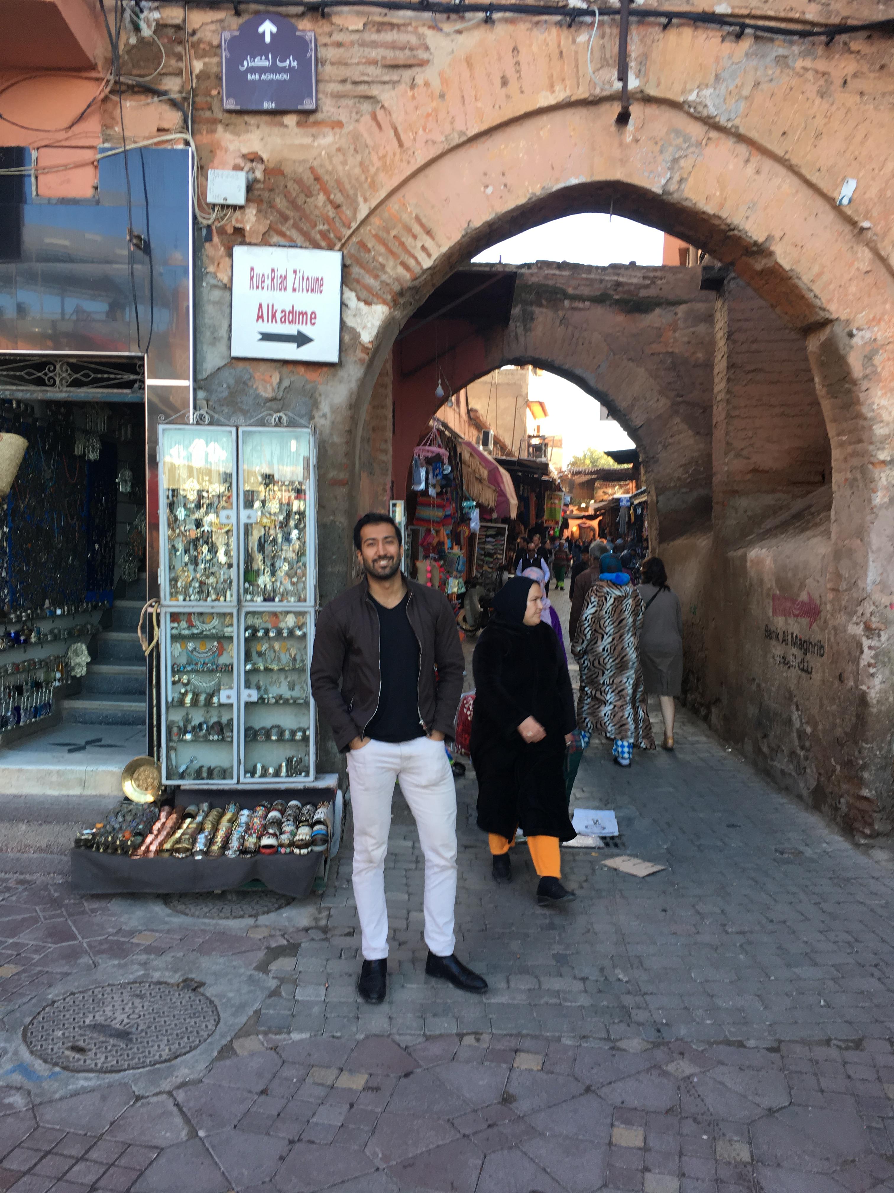 Zach standing next to alley arch.