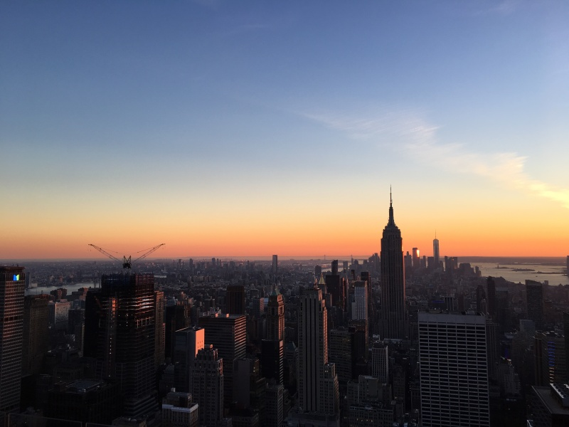 Sunset over new york city with view of empire state building.