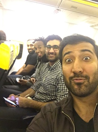 Zach, Aaqib, Leben and Qasim sitting together in a plane.