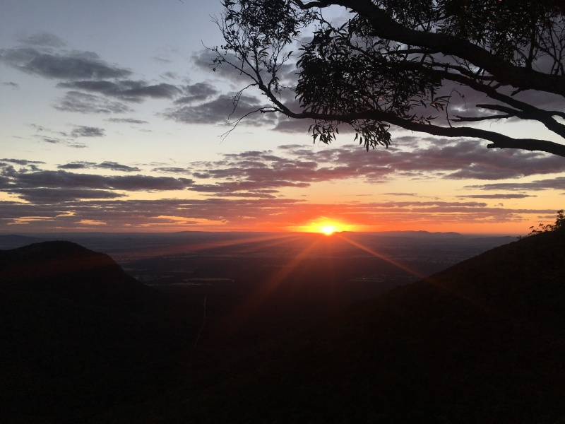 Sunrise as seen from a mountain edge.