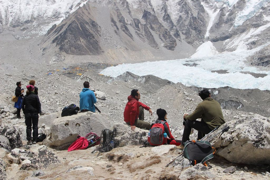 The team taking a break with Everest Base Camp in view