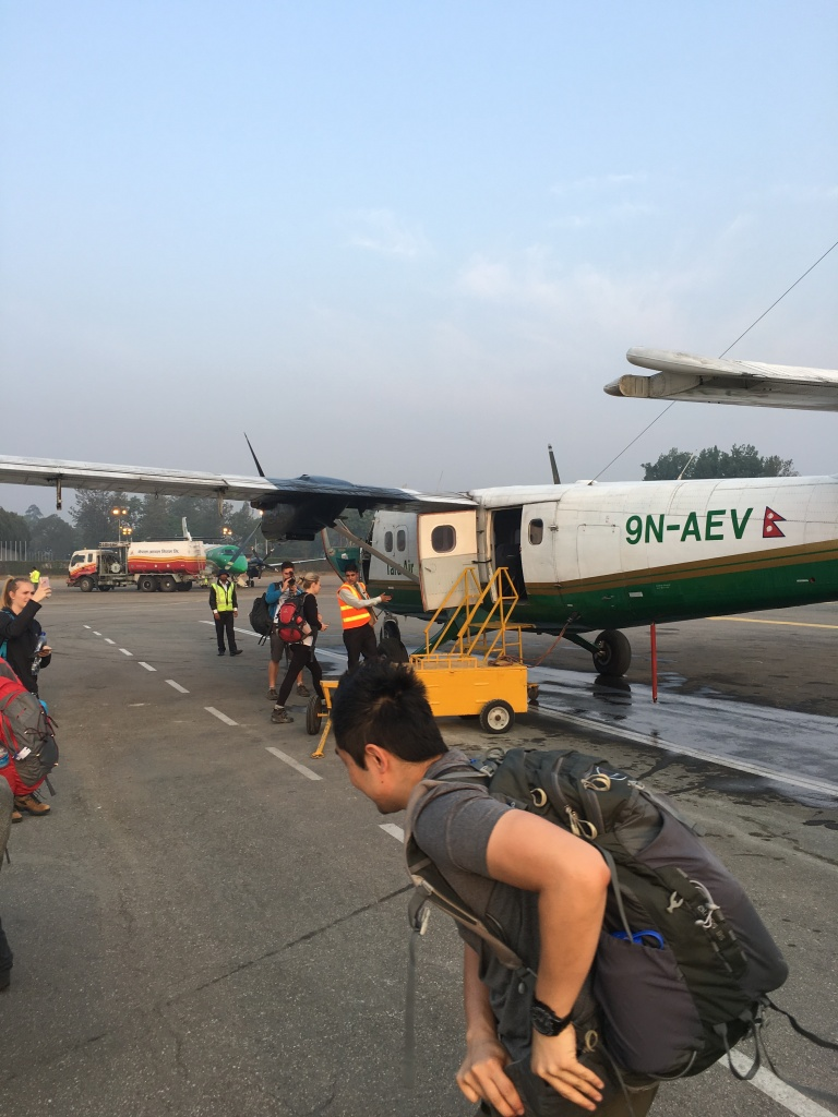 Leo heading for twin otter plane in nepal local airport