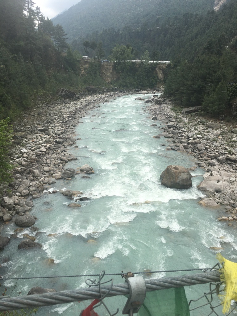 View of river under suspension bridge to Phakding