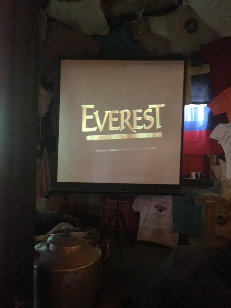 Projector screen showing Everest movie