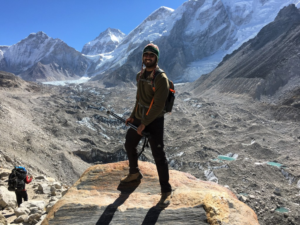 Zach posing with Everest base camp in the backdrop
