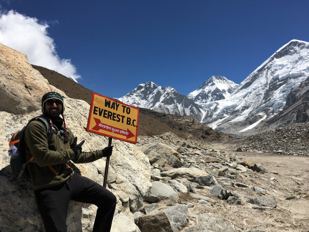Zach standing next to Everest Base Camp signpost