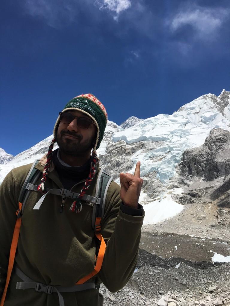 Peek of Everest's summit behind Nuptse